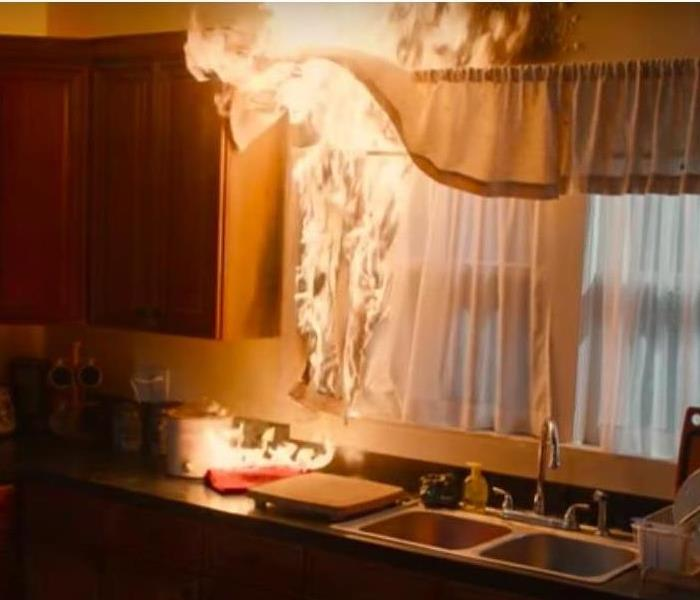 kitchen curtains on fire above sink